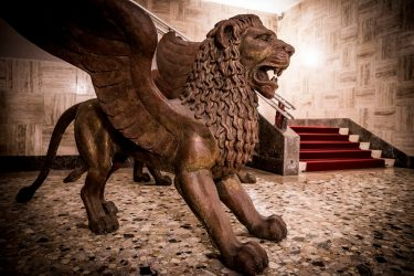 VENICE, ITALY - SEPTEMBER 04:  (EDITORS NOTE: This image was processed using digital filters) Statues of the Golden Lion (Leone d'Oro) are displayed in Palazzo del Casino as Jaeger-LeCoultre sponsers the 75th Venice Film Festival on September 4, 2018 in Venice, Italy.  (Photo by Tristan Fewings/Getty Images for Jaeger-LeCoultre)
