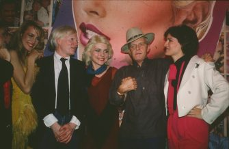 NEW YORK, NY - JUNE 1979:  Jerry Hall, Andy Warhol, Debbie Harry, Truman Capote, and Paloma Picasso at Interview party at Studio 54, June 1979 in New York City.  (Photo by Sonia Moskowitz/Getty Images)