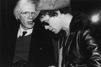 American Pop artist Andy Warhol (1928 - 1987) (left) speaks with singer and musician Lou Reed (1942 - 2013) durin an event in the Studio 54 nightclub, New York, New York, 1977. (Photo by Rose Hartman/Getty Images)