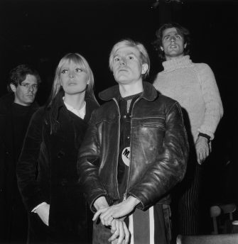 4th December 1966:  Left to right: Director Paul Morrissey, singer Nico (1938 - 1988), artist Andy Warhol (1928 - 1987) and poet Gerard Malanga attend a 'Freakout' party featuring a Velvet Underground and Nico performance at the Action House, Island Park, Long Island, New York.  (Photo by Tim Boxer/Hulton Archive/Getty Images)