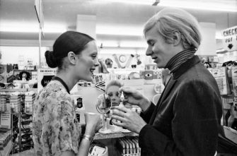 Jane Forth and Andy Warhol shopping for cosmetics, 1970. (Photo by Jack Mitchell/Getty Images)