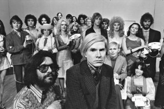 Andy Warhol with the cast of Pork on stage at La Mama Experimental Theatre Club. Jayne (aka Wayne) County, Cleve Roller and Anthony Zanetta were featured players. (Photo by Jack Mitchell/Getty Images)
