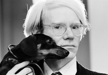 Andy Warhol poses with his beloved dachshund Archie in November 1973. (Photo by Jack Mitchell/Getty Images)
