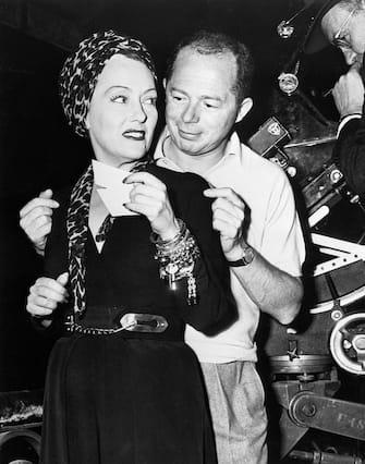 "(Original Caption) 1949: Billy Wilder and Gloria Swanson on the set of ""Sunset Boulevard."""