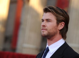 """LOS ANGELES, CA - MAY 02:  Actor Chris Hemsworth arrives at the premiere of Paramount Pictures' and Marvel's """"Thor"""" held at the El Capitan Theatre on May 2, 2011 in Los Angeles, California.  (Photo by Kevin Winter/Getty Images)"""