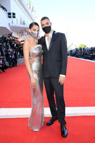 """VENICE, ITALY - SEPTEMBER 02: Marracash and Elodie walk the red carpet ahead of the Opening Ceremony and the """"Lacci"""" red carpet during the 77th Venice Film Festival at  on September 02, 2020 in Venice, Italy. (Photo by Pascal Le Segretain/Getty Images)"""