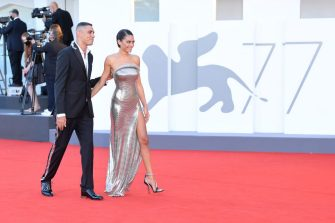 """VENICE, ITALY - SEPTEMBER 02: Marracash and Elodie walk the red carpet ahead of the Opening Ceremony and the """"Lacci"""" red carpet during the 77th Venice Film Festival at  on September 02, 2020 in Venice, Italy. (Photo by Daniele Venturelli/WireImage,)"""