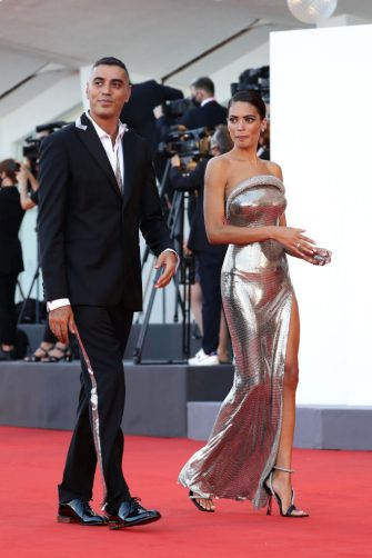 """VENICE, ITALY - SEPTEMBER 02: Marracash and Elodie walk the red carpet ahead of the Opening Ceremony and the """"Lacci"""" red carpet during the 77th Venice Film Festival at  on September 02, 2020 in Venice, Italy. (Photo by Vittorio Zunino Celotto/Getty Images)"""