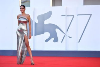 """Italian singer Elodie Di Patrizi arrives for the opening ceremony and the screening of the film """"Lacci"""" on the opening day of the 77th Venice Film Festival, on September 2, 2020 at Venice Lido, during the COVID-19 infection, caused by the novel coronavirus. (Photo by Tiziana FABI / AFP) (Photo by TIZIANA FABI/AFP via Getty Images)"""
