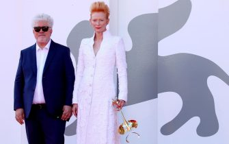 """VENICE, ITALY - SEPTEMBER 03: Pedro Almodovar and Tilda Swinton walk the red carpet ahead of the movie """"The Human Voice"""" at the 77th Venice Film Festival at  on September 03, 2020 in Venice, Italy. (Photo by Franco Origlia/Getty Images)"""