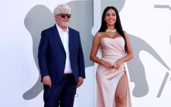 """VENICE, ITALY - SEPTEMBER 03: Georgina Rodriguez and Pedro Almodovar walk the red carpet ahead of the movie """"The Human Voice"""" at the 77th Venice Film Festival at  on September 03, 2020 in Venice, Italy. (Photo by Franco Origlia/Getty Images)"""