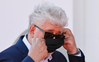 """Spanish director Pedro Almodovar puts on his face mask as he arrives for the screening of the film """"The Human Voice"""" presented out of competition on the second day of the 77th Venice Film Festival, on September 3, 2020 at Venice Lido, during the COVID-19 infection, caused by the novel coronavirus. (Photo by Alberto PIZZOLI / AFP) (Photo by ALBERTO PIZZOLI/AFP via Getty Images)"""