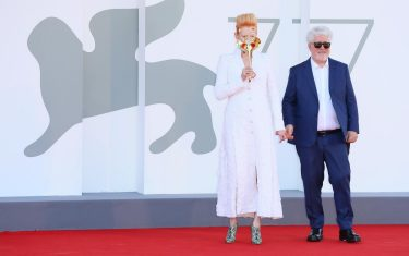 """VENICE, ITALY - SEPTEMBER 03: Tilda Swinton and Director Pedro Almodóvar walk the red carpet ahead of the movie """"The Human Voice"""" and """"Quo Vadis, Aida?"""" at the 77th Venice Film Festival at  on September 03, 2020 in Venice, Italy. (Photo by Ernesto S. Ruscio/Getty Images)"""