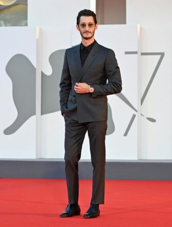 """French actor Pierre Niney arrives for the screening of the film """"Amants"""" (Lovers) presented in competition on the second day of the 77th Venice Film Festival, on September 3, 2020 at Venice Lido, during the COVID-19 infection, caused by the novel coronavirus. (Photo by Alberto PIZZOLI / AFP) (Photo by ALBERTO PIZZOLI/AFP via Getty Images)"""