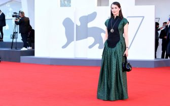 """VENICE, ITALY - SEPTEMBER 03: Amira Casar walks the red carpet ahead of the movie """"Amants"""" at the 77th Venice Film Festival at  on September 03, 2020 in Venice, Italy. (Photo by Daniele Venturelli/WireImage,)"""