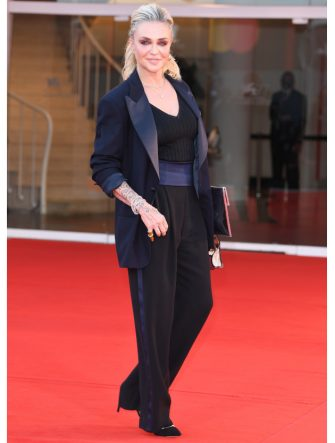 """VENICE, ITALY - SEPTEMBER 04: Paola Barale walks the red carpet ahead of the movie """"Padrenostro"""" at the 77th Venice Film Festival at  on September 04, 2020 in Venice, Italy. (Photo by Daniele Venturelli/WireImage,)"""