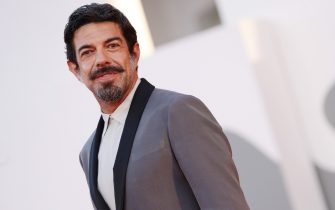 """VENICE, ITALY - SEPTEMBER 04: Pierfrancesco Favino walks the red carpet ahead of the movie """"Padrenostro"""" at the 77th Venice Film Festival at  on September 04, 2020 in Venice, Italy. (Photo by Vittorio Zunino Celotto/Getty Images)"""
