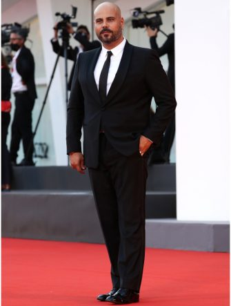 """VENICE, ITALY - SEPTEMBER 04: Marco D'Amore walks the red carpet ahead of the movie """"Padrenostro"""" at the 77th Venice Film Festival at  on September 04, 2020 in Venice, Italy. (Photo by Vittorio Zunino Celotto/Getty Images)"""