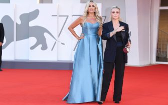 """VENICE, ITALY - SEPTEMBER 04: Tiziana Rocca and Paola Barale walk the red carpet ahead of the movie """"Padrenostro"""" at the 77th Venice Film Festival at  on September 04, 2020 in Venice, Italy. (Photo by Daniele Venturelli/WireImage,)"""