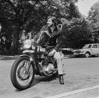 Australian actor and former model George Lazenby on his motorcycle, UK, 27th July 1970. (Photo by Dove/Daily Express/Hulton Archive/Getty Images)