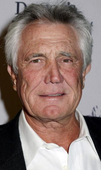 LOS ANGELES - NOVEMBER 1:  Actor George Lazenby attends the Dressed To Kilt Charity Event at the Wiltern on November 1, 2003 in Los Angeles, California.  (Photo by Giulio Marcocchi /Getty Images)