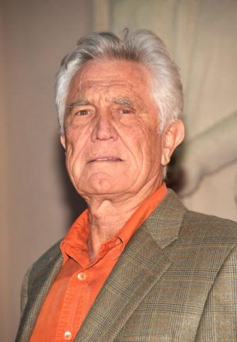"""LOS ANGELES, CA - JUNE 12:  Actor George Lazenby arrives at the premiere of the new film """"Raven"""", held at the Goldenson Theater at the Academy of Television Arts & Sciences on June 12, 2009 in Los Angeles, California.  (Photo by Michael Tullberg/Getty Images)"""