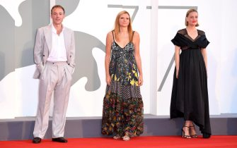"""VENICE, ITALY - SEPTEMBER 05: (L-R) Patrick Kennedy, Director Susanna Nicchiarelli and Romola Garai walk the red carpet ahead of the movie """"Miss Marx"""" at the 77th Venice Film Festival on September 05, 2020 in Venice, Italy. (Photo by Daniele Venturelli/WireImage,)"""