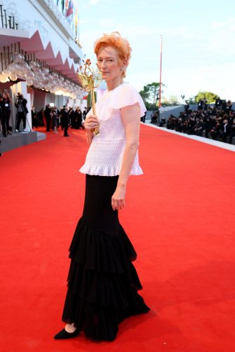 """VENICE, ITALY - SEPTEMBER 02: Actress Tilda Swinton walks the red carpet ahead of the Opening Ceremony and the """"Lacci"""" red carpet during the 77th Venice Film Festival at  on September 02, 2020 in Venice, Italy. (Photo by Pascal Le Segretain/Getty Images)"""