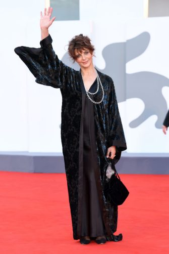 """VENICE, ITALY - SEPTEMBER 02: Laura Morante walks the red carpet ahead of the Opening Ceremony and the """"Lacci"""" red carpet during the 77th Venice Film Festival at  on September 02, 2020 in Venice, Italy. (Photo by Daniele Venturelli/WireImage,)"""
