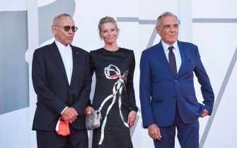 """Director of the Venice Film festival, Alberto Barbera (R) greets Russian director Andrei Konchalovsky and Russian actress Julia Vysotskaya as they arrive for the screening of the film """"Dorogie Tovarischi! (Dear Comrades!)"""" presented in competition on the sixth day of the 77th Venice Film Festival, on September 7, 2020 at Venice Lido, during the COVID-19 infection, caused by the novel coronavirus. (Photo by Tiziana FABI / AFP) (Photo by TIZIANA FABI/AFP via Getty Images)"""