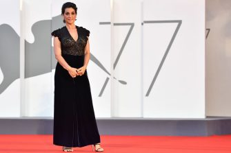 "Italian actress Donatella Finocchiaro arrives for the screening of the film ""Le Sorelle Macaluso"" presented in competition on the eighth day of the 77th Venice Film Festival, on September 9 , 2020 at Venice Lido, during the COVID-19 infection, caused by the novel coronavirus. (Photo by Tiziana FABI / AFP) (Photo by TIZIANA FABI/AFP via Getty Images)"