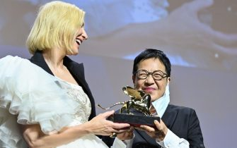 Hong-Kong director Ann Hui (R) acknowledges receiving a Golden Lion award for Lifetime Achievement from Jury President of the 77th Venice Film festival, Australian-US actress Cate Blanchett, during a ceremony on the seventh day of the 77th Venice Film Festival, on September 8, 2020 at Venice Lido, during the COVID-19 infection, caused by the novel coronavirus. (Photo by Alberto PIZZOLI / AFP) (Photo by ALBERTO PIZZOLI/AFP via Getty Images)