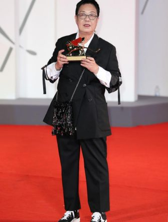 VENICE, ITALY - SEPTEMBER 08:  Director Ann Hui poses on the red carpet with the Golden Lion Lifetime achievement award during the Golden Lion For Lifetime Achivement Award Ceremony at the 77th Venice Film Festival on September 08, 2020 in Venice, Italy. (Photo by Ernesto Ruscio/Getty Images)
