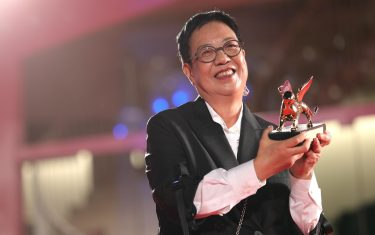 """VENICE, ITALY - SEPTEMBER 08: Director Ann Hui poses on the red carpet with the Golden Lion Lifetime achievement award after the movie """"Di Yi Lu Xiang"""" (Love After Love) at the 77th Venice Film Festival on September 08, 2020 in Venice, Italy. (Photo by Vittorio Zunino Celotto/Getty Images)"""