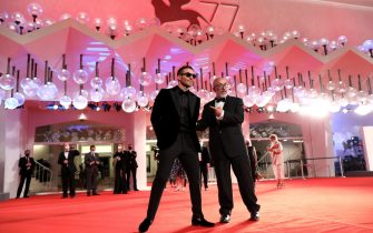 """VENICE, ITALY - SEPTEMBER 11: Miguel Ángel Silvestre and Director Álex de la Iglesia walk the red carpet ahead of the movie """"30 Monedas"""" (30 Coins) - Episode 1 at the 77th Venice Film Festival on September 11, 2020 in Venice, Italy. (Photo by Elisabetta Villa/Getty Images)"""