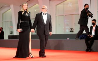 """VENICE, ITALY - SEPTEMBER 11: Carolina Bang and Director Álex de la Iglesia walk the red carpet ahead of the movie """"30 Monedas"""" (30 Coins) - Episode 1 at the 77th Venice Film Festival on September 11, 2020 in Venice, Italy. (Photo by Elisabetta Villa/Getty Images)"""