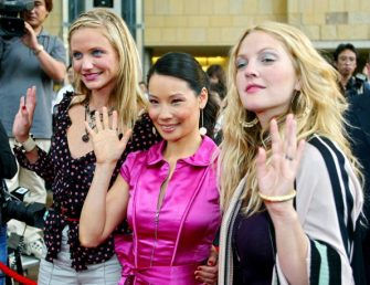 "US actress Cameron Diaz (L), Lucy Liu (C) and Drew Barrymore (R) wave to photographers upon their arrival at a press conference in Tokyo 02 June 2003. The three actresses are here to promote their new movie ""Charlie's Angels"" which will be shown from 28 June all over Japan.          AFP PHOTO/Toru YAMANAKA  (Photo credit should read TORU YAMANAKA/AFP via Getty Images)"