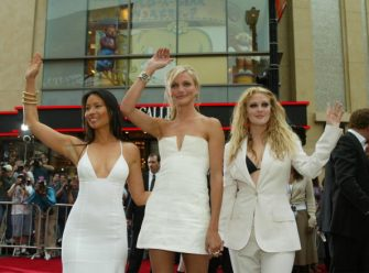 "HOLLYWOOD, CA - JUNE 18:    Actresses Lucy Liu, Cameron Diaz, and Drew Barrymore arrive to the premiere of Columbia Pictures' film ""Charlie's Angels 2: Full Throttle"" at the Grauman's Chinese Theatre June 18, 2003 in Hollywood, California.  The film will be released nationwide June 27, 2003.  (Photo by Kevin Winter/Getty Images)"