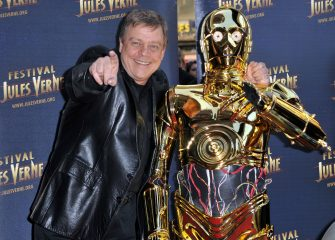 PARIS - APRIL 23:  Actor Mark Hamill poses with C-3PO as he attends a Tribute to Star Wars V during the 18th Adventure Film Festival at Le Grand Rex on April 23, 2010 in Paris, France.  (Photo by Pascal Le Segretain/Getty Images)