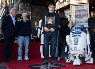 Actor Mark Hamill (L) and director George Lucas attend a ceremony honoring Mark Hamill with a star on the Hollywood Walk of Fame on March 8, 2018, in Hollywood, California. / AFP PHOTO / VALERIE MACON        (Photo credit should read VALERIE MACON/AFP via Getty Images)