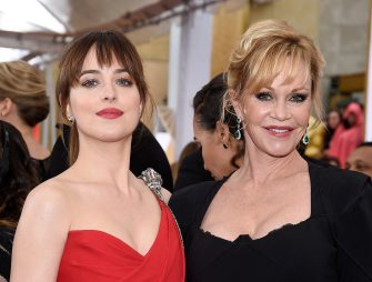 HOLLYWOOD, CA - FEBRUARY 22:  Actresses Melanie Griffith (R) and Dakota Johnson attend the 87th Annual Academy Awards at Hollywood & Highland Center on February 22, 2015 in Hollywood, California.  (Photo by Kevork Djansezian/Getty Images)