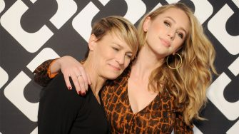 """LOS ANGELES, CA - JANUARY 10:  Actress Robin Wright and daughter Dylan Penn arrive at Diane Von Furstenberg's """"Journey Of A Dress"""" premiere opening party at Wilshire May Company Building on January 10, 2014 in Los Angeles, California.  (Photo by Gregg DeGuire/WireImage)"""