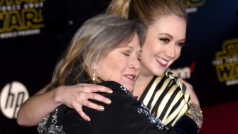 """HOLLYWOOD, CA - DECEMBER 14:  Actresses Carrie Fisher (L) and Billie Lourd attend the Premiere of Walt Disney Pictures and Lucasfilm's """"Star Wars: The Force Awakens"""" at the Dolby Theatre on December 14, 2015 in Hollywood, California.  (Photo by Ethan Miller/Getty Images)"""