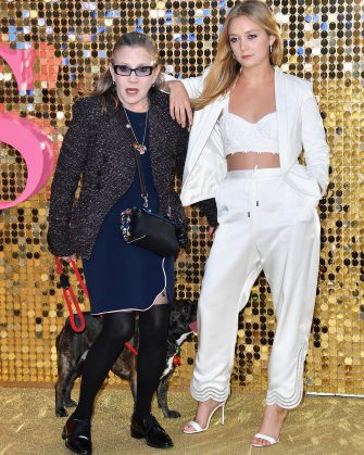 """LONDON, ENGLAND - JUNE 29:  Carrie Fisher and Billie Catherine Lourd attend the """"Absolutely Fabulous: The Movie""""  World Premiere at the Odeon Leicester Square on June 29, 2016 in London, England.  (Photo by Gareth Cattermole/Getty Images)"""