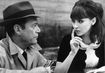 EDDIE CONSTANTINE & ANNA KARINA in Alphaville *Editorial Use Only* www.capitalpictures.com sales@capitalpictures.com Supplied by Capital Pictures