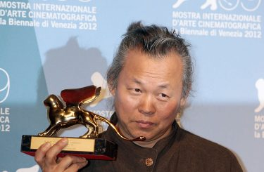 VENICE, ITALY - SEPTEMBER 08:  Director Kim Ki-Duk poses with the Golden Lion for Best Film 'Pieta' at the Award Winners Photocall during The 69th Venice Film Festival at the Palazzo del Cinema on September 8, 2012 in Venice, Italy.  (Photo by Elisabetta A. Villa/WireImage)
