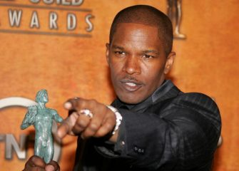 """LOS ANGELES - FEBRUARY 05: Actor Jamie Foxx poses in the press room with his Actor for Outstanding Performance by a Male Actor in a Leading Role for """"Ray"""" at the 11th Annual Screen Actors Guild Awards at the Shrine Exposition Center on February 5, 2005 in Los Angeles, California. (Photo by Vince Bucci/Getty Images)"""