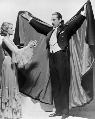 Actor Bela Lugosi draws in another pretty young victim as the Count himself in the horror classic, Dracula.