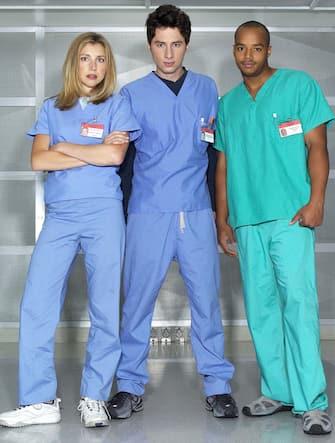 "SCRUBS -- NBC Series -- Pictured: (l-r) Sarah Chalke as Elliott Reid, Zach Braff as John ""J.D."" Dorian, Donald Faison as Chris Turk -- NBC Photo: Chris Haston"
