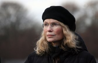 """US actress and UNICEF ambassador Mia Farrow stands in front of steles of Berlin's Holocaust Memorial 29 November 2007, where she attended a symbolic Olympic torch relay of the initiative """"Save Darfur"""". The relay, which started on 09 August 2007 at the border between Darfur and Tchad, aims to call attention on violations of human rights in Darfur.       AFP PHOTO    DDP/MICHAEL KAPPELER    GERMANY OUT (Photo credit should read MICHAEL KAPPELER/DDP/AFP via Getty Images)"""